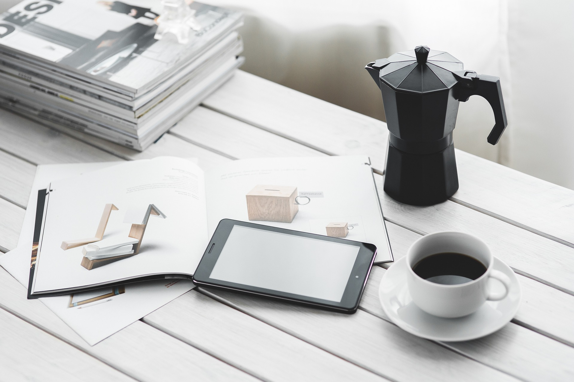 Cup of coffee next to a mobile